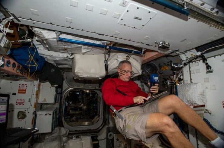 Hurley works on the International Space Station